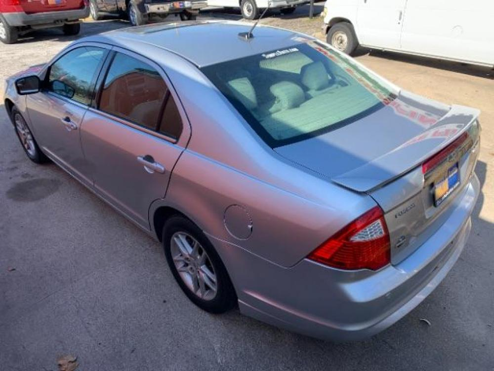 2011 Ingot Silver Metalli /Sport Blue Leather I Ford Fusion V6 Sport FWD (3FAHP0KC0BR) with an 3.5L V6 DOHC 24V engine, located at 11700 Garland Rd., Dallas, TX, 75218, (214) 321-6450, 32.852482, -96.678986 - Photo #6