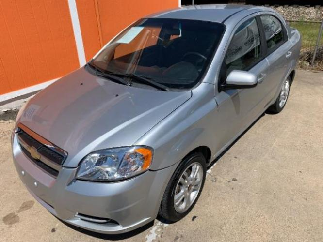 2011 Silver Ice Metallic Chevrolet Aveo LT 4-Door (KL1TD5DEXBB) with an 1.6L L4 DOHC 16V engine, located at 11700 Garland Rd., Dallas, TX, 75218, (214) 321-6450, 32.852482, -96.678986 - Photo #0
