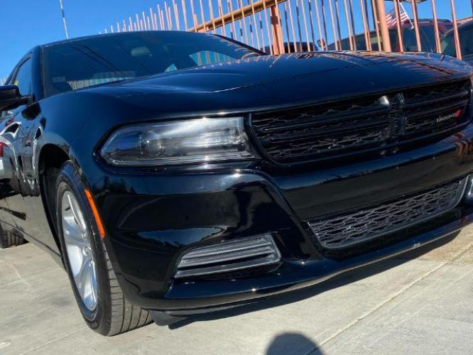 2019 Dodge Charger SXT (2C3CDXBG9KH) with an 3.6L V6 DOHC 24V engine, 8-Speed Automatic transmission, located at 11700 Garland Rd., Dallas, TX, 75218, (214) 321-6450, 32.852482, -96.678986 - Photo #0